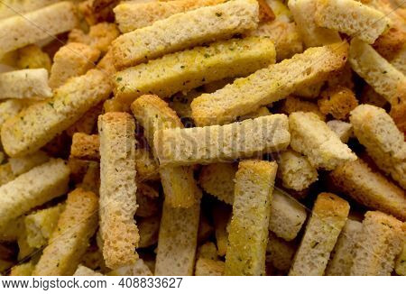 Breadcrumbs In Cubes And Sticks Close-up. Bread. Breadcrumbs For Beer.croutons