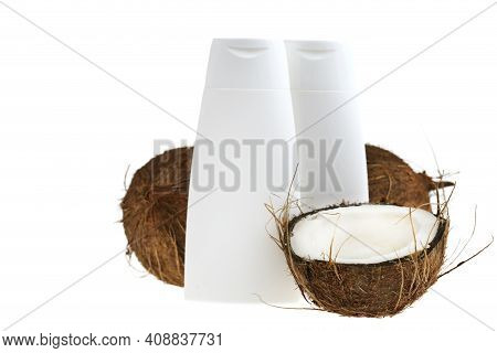 Coconut Oil. White Bottles Mockup And Coconuts Set With Palm Green Leaf Isolated On White Background