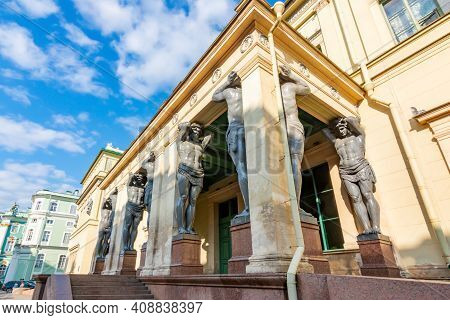 Portico Of New Hermitage Building With Atlantes In Saint Petersburg, Russia