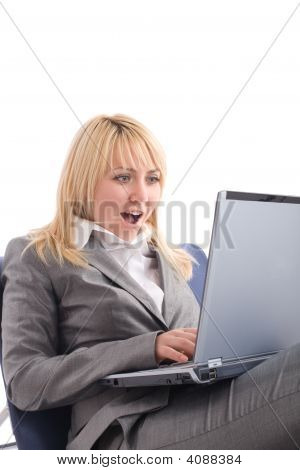 Amazed Businesswoman With Laptop In Chair Over White