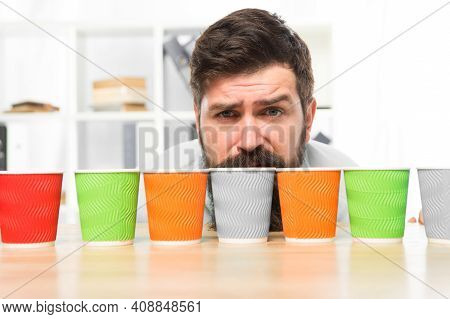 Choose From Alternatives. Man Bearded Choosing One Of Lot Colorful Paper Cups. Alternative Concept.