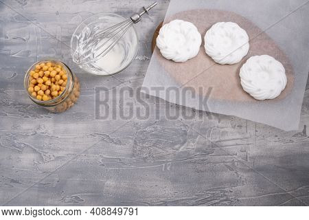 Vegan Meringues With Whipped Aquafaba - Chickpea Water. Bowl With Chickpea And Jar With Boiled Chick