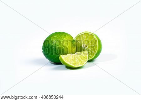 Two Whole Limes And Slice Of Lime Fruit Isolated On White Background With Clipping Path