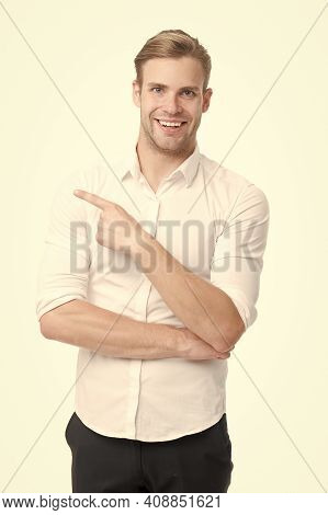 In That Direction. Happy Man Pointing Index Finger Isolated On White. Pointing For Advertising. Poin
