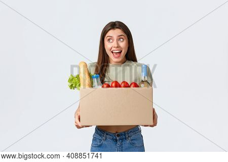 Online Home Delivery, Internet Orders And Grocery Shopping Concept. Excited Woman Satisfied With Qua