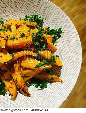 Baked Sweet Potatoes Cut Into Sticks, Baked Vegetables, Sweet Potato Sprinkled With White Sesame And
