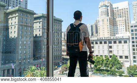San Francisco, Usa - August 2019: Young Man Looking At Union Square View From Top Floor Of Macys Sto