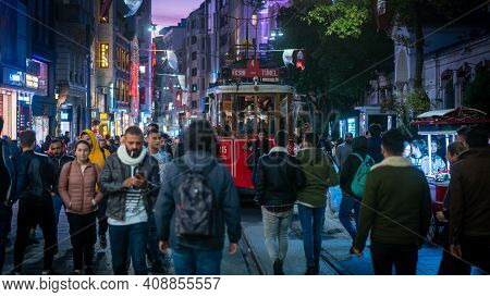 Istanbul, Turkey - November 2019: Taksim Old Tram Moves Along Istiklal Street Through A Crowd Of Peo