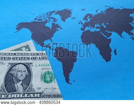 American One Dollar Bill And Background With A World Map In Black And Blue