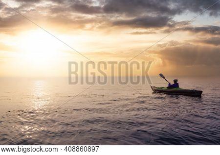Girl Kayaking On An Inflatable Kayak In Howe Sound. Dramatic Sunset Sky Art Render. Taken In West Va