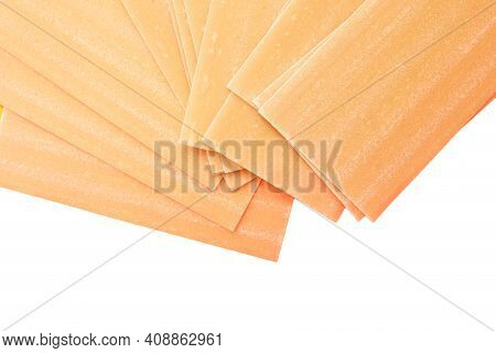 Uncooked Lasagna Pasta Isolated On White Background. Pile Of Dried Uncooked Lasagna Pasta Sheets