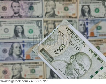 Approach To Indian Banknote And Background With American Dollar Bills