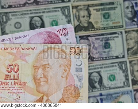 Approach To Turkish Banknotes And Background With American Dollar Bills