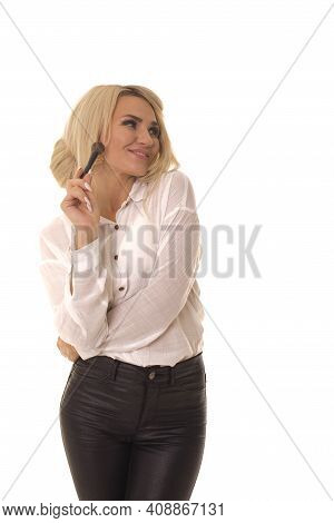 Girl Standing On A White With A Makeup Brush.