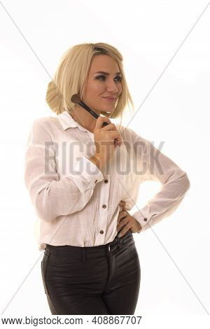Blonde With Makeup Brush Posing For The Camera.