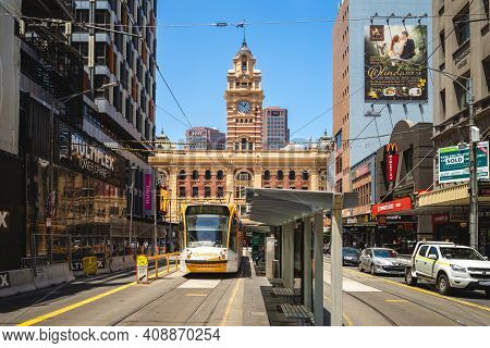 January 1, 2019: Tram Line In Front Of The Clock Tower Of Flinders Street Railway Station. Flinders