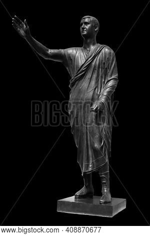 Statue of Roman statesman, lawyer, orator and philosopher. Isolated on black. Ancient antique roman sculpture