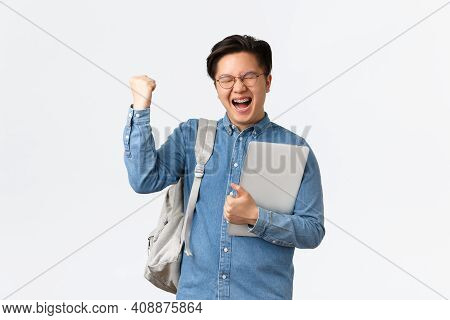 University, Study Abroad And Lifestyle Concept. Happy Rejoicing Asian Male Student With Braces Trium