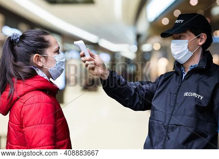 Security Guard Temperature Scan At Shopping Mall