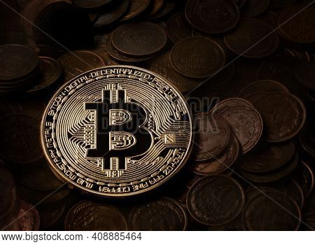 Golden Bitcoin On The Background Of Coins. Bitcoin On Kopeks From The Ussr.