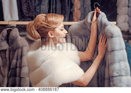 Customer Woman Buy Furry Coat. Fashion And Shopping Concept. Expensive Sable Overcoats On. Girl With