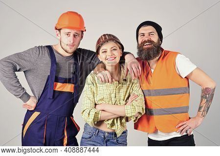 Teamwork, Brigade. Company Of Cheerful Workers, Builder, Repairer, Plasterer. Group Of Man And Woman