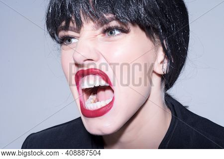Woman With Open Screaming Mouth. Angry Female Concept. Girl Scream On Grey Background