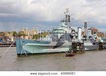 London England - famous historic ship HMS Belfast. Light cruiser navy vessel moored in Thames River. poster