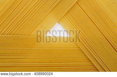 Thin Pasta Arranged In Rows. Yellow Italian Pasta. Long Spaghetti. Raw Spaghetti Wallpaper. Thin Spa