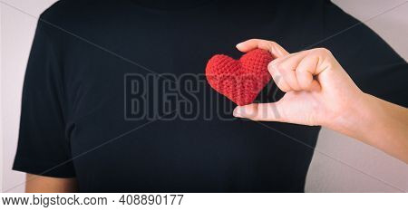 Hands Holding Red Heart On Black Isolated Background, Copy Space, Concept Of Love, Hope,healthcare,o