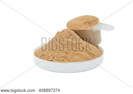 Whey Protein Powder Isolated On White Background. Plastic Measuring Dietary Spoon And Heap Of Chocol