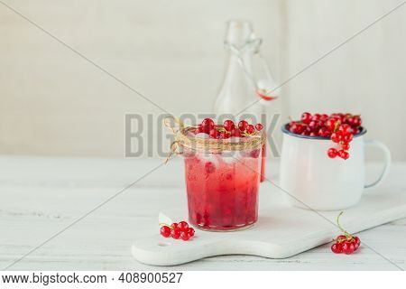 Glass Of Red Currant Cocktail Or Mocktail, Refreshing Summer Drink With Crushed Ice And Sparkling Wa