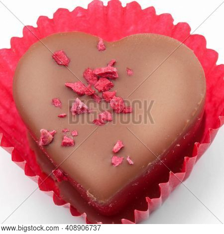 Praline candy in red paper wrap