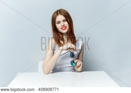 Cheerful Red-haired Woman With Red Lips Sits At The Table Glamor Glamor
