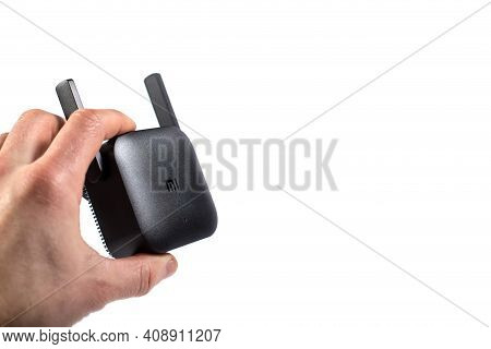 Black Wifi Amplifier Pro In Hand Close Up, Isolated On A White, With Copy Space.