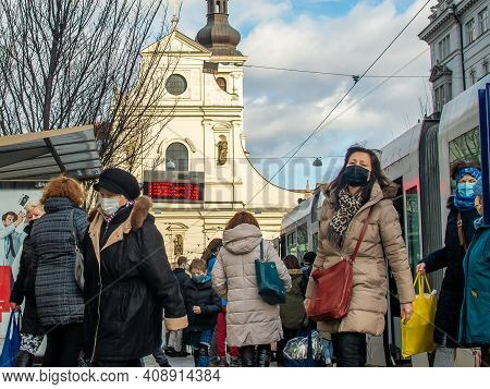 Brno, Czech Republic. 02-17-2021. People With Face Mask To Protect Corona Virus On Cheska Tram Stop