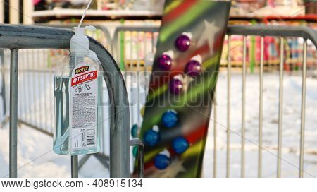 Disinfectant Near The Ticket Booth In An Amusement Park. Close-up Of A Disinfectant With A Label Tha