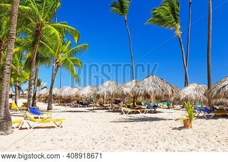 Beautiful White Sandy Beach Of A Luxury Resort In Punta Cana, Dominican Republic. Vacation Holidays