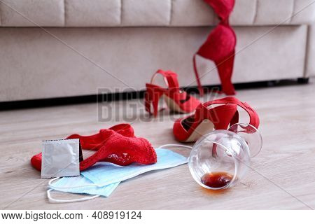 Safe Sex During Coronavirus Pandemic, Two Medical Masks, Red Lace Lingerie, Wine Glass And Shoes On
