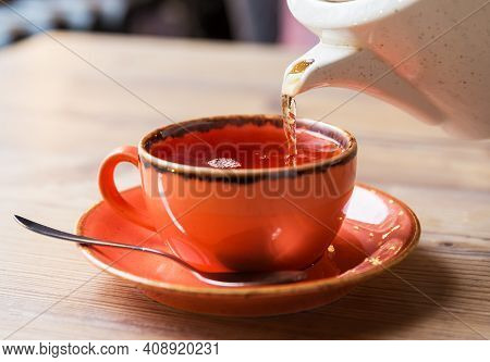 Tea Cup With Hot Tea Pot