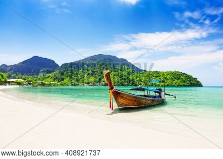 Thai Traditional Wooden Longtail Boat And Beautiful Sand Beach At Koh Phi Phi Island In Krabi Provin