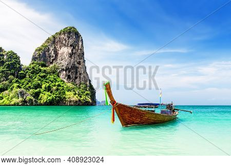 Thai Traditional Wooden Longtail Boat And Beautiful Sand Railay Beach In Krabi Province In Thailand.