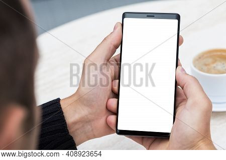 Close Up Of Man's Hands Holding Mobile Smart Phone.