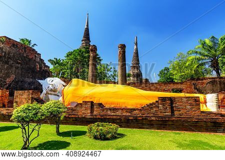 Sleeping Buddha Statue Covered With A Yellow Robe In Wat Yai Chai Mongkhon Temple In Phra Nakhon Si