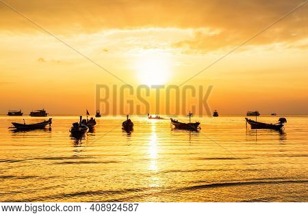 Thai Longtail Boats At Sunset. Traditional Longtail Boat Silhouettes At Sea During Golden Sunset In