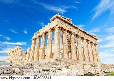 Parthenon temple in sunny day. Acropolis in Athens, Greece. The Parthenon is a temple on the Athenian Acropolis in Greece, dedicated to the goddess Athena.