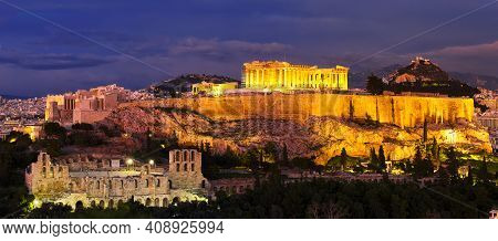Panorama of Athens with Acropolis hill at dramatic sunset, Greece. The Acropolis of Athens located on a rocky outcrop above the city of Athens and contains the remains of several ancient buildings, the most famous being the Parthenon.