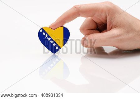 Bosnia And Herzegovrina Flag. Love And Respect Bosnia And Herzegovina. A Man's Hand Holds A Heart In