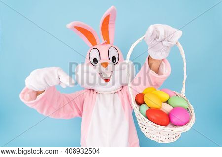 Easter Bunny Or Rabbit Or Hare With Basket Of Colored Eggs, Shows Thumb Finger Up, Having Fun, Danci