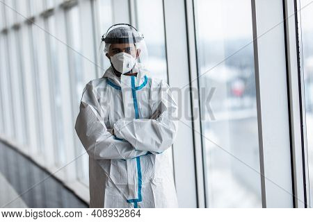 Doctor Wearing Face Surgical Mask And Visor Fighting Against Corona Virus Outbreak. Health Care And